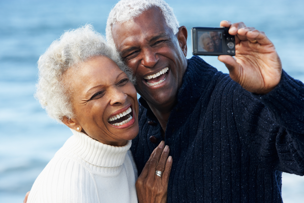 Older Black Couple taking a selfie